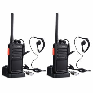This is an image of two black Floureon Rechargeable walkie talkies with headsets plugged in