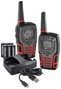 This is an image of black and red Cobra Electronics CXT545 with charging dock, USB cable and rechargeable batteries
