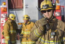 This is an image of a fireman using a walkie talkie