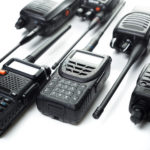 this is an image of 6 walkie talkies laying down flat on a table