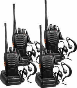 This is an image of 4 black Arcshell AR-5. Walkie Talkies with earpiece and charger