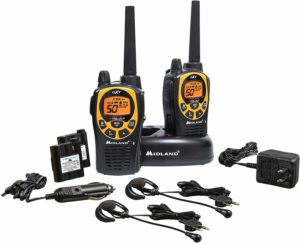 This is an image of two black Midland GXT1030VP4 walkie talkies with chargers and headsets