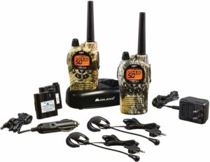 This is an image of two Midland GXT1050VP4 walkie talkies, headsets, chargers and battery