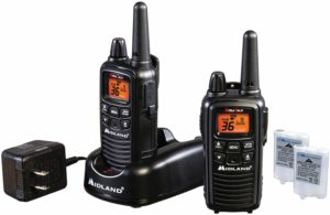 This is an image of black Midland LXT600VP3 walkie talkie and a charging dock