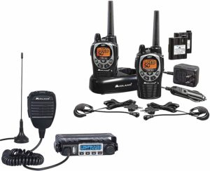 This is an image of Midland MXT115 & GXT1000 black walkie talkies, with chargers and headset