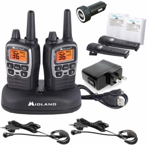 This is an image of Midland X TALKER T77VP5 walkie talkie with hedsets, charger, adapter and a charging dock