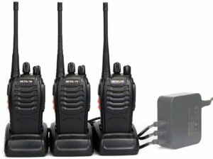 This is an image of three Black Retevis H-777 with a charging dock