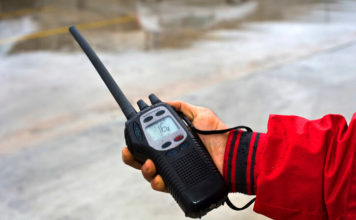 Holding handheld marine VHF Radio under the rain