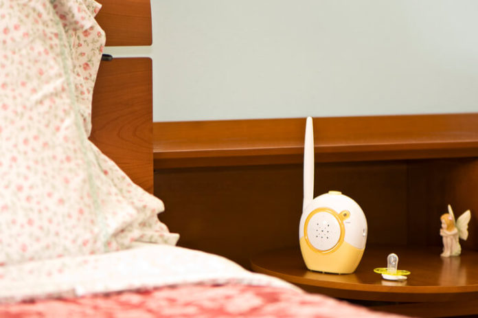 image of a Walkie Talkie Baby Monitor next to bed