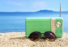 Old fashion radio and sunglasses on the beachOld fashion radio and sunglasses on the beach